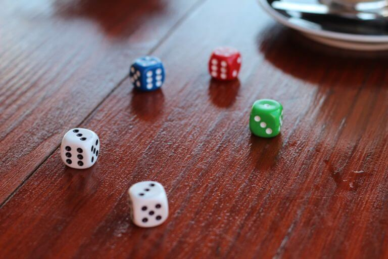 colored dice on table